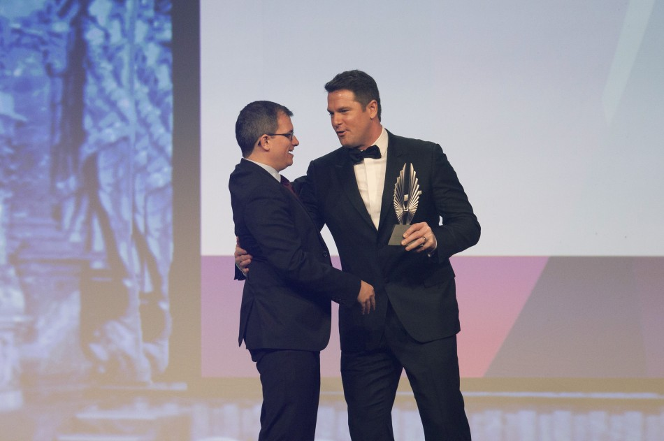 Journalist Thomas Roberts presents Chris Geidner an award for Outstanding Magazine Article at the 23rd annual GLAAD Media Awards in New York