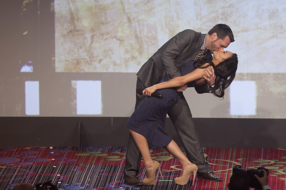 Actress Rivera is kissed by a man who made the highest bid to kiss her at the 23rd annual GLAAD Media Awards in New York
