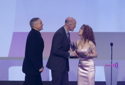 Producers Zadan and Meron accept their award from actress Bernadette Peters at the 23rd annual GLAAD Media Awards in New York
