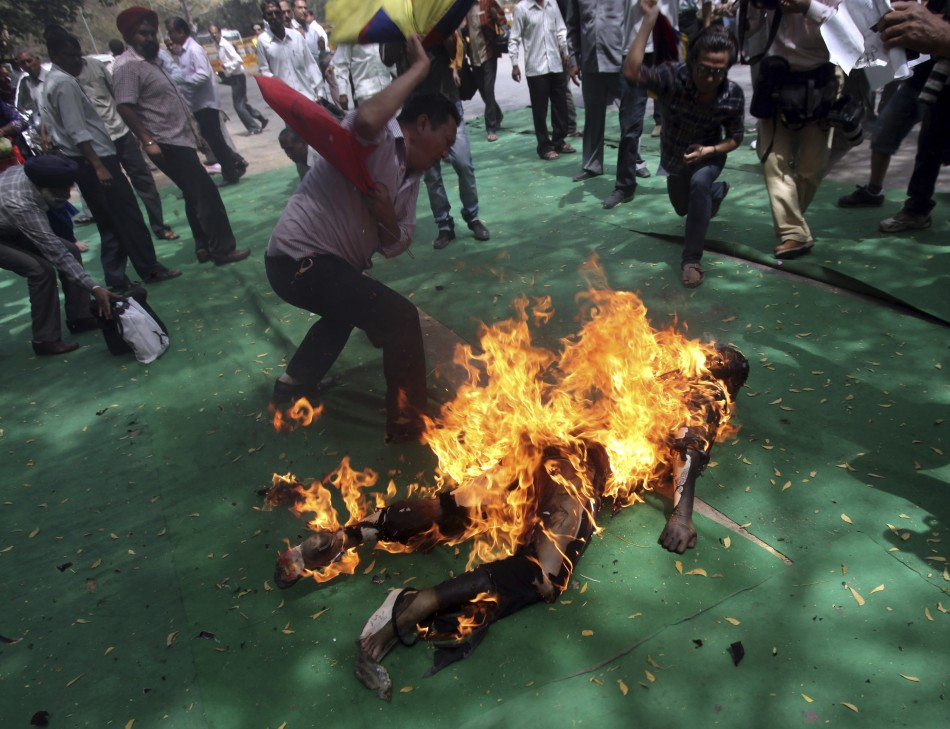 Other Tibetans tried to extinguish flames