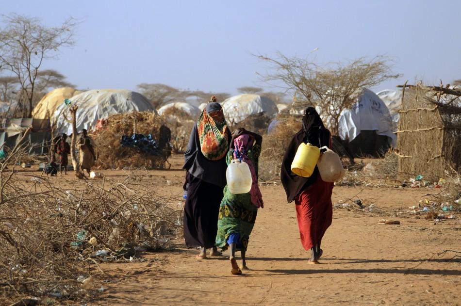 Malian women fetch water from communal tap in Kenya's Dadaab refugee camp