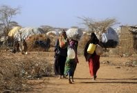 Malian women fetch water from communal tap in Kenya's Dadaab refugee camp