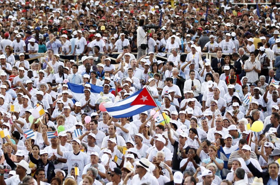 A man waves a Cuban flag