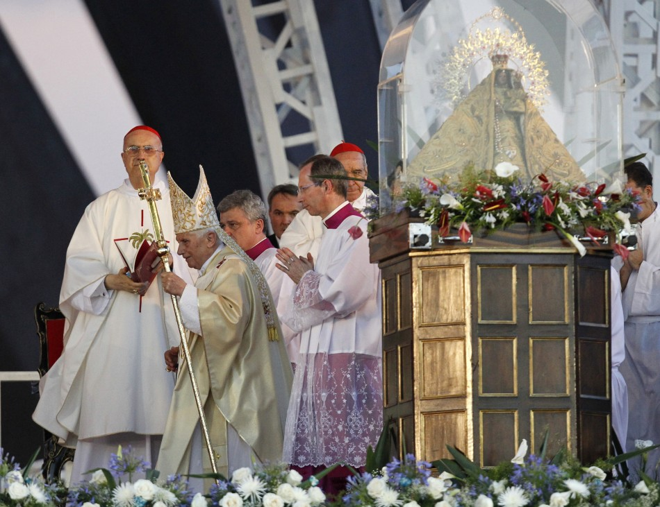Pope Benedict XVI 2nd L walks past Our Lady of Charity