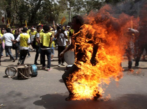 Tibetan activist and exile Jamphel Yeshi, 27, set himself alight and ran through streets of New Delhi to protest against arrival of Chinese President Hu Jintao for meeting of Brics nations in March. Yeshi died in the incident.