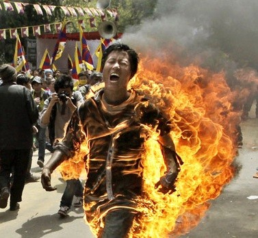 Tibetan activist and exile Jamphel Yeshi, 27, runs through the streets on fire