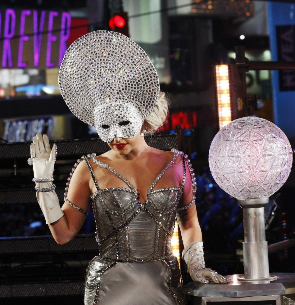 Singer Lady Gaga waves to the crowd as she arrives to activate the New Years Eve ball during celebrations at Times Square in New York
