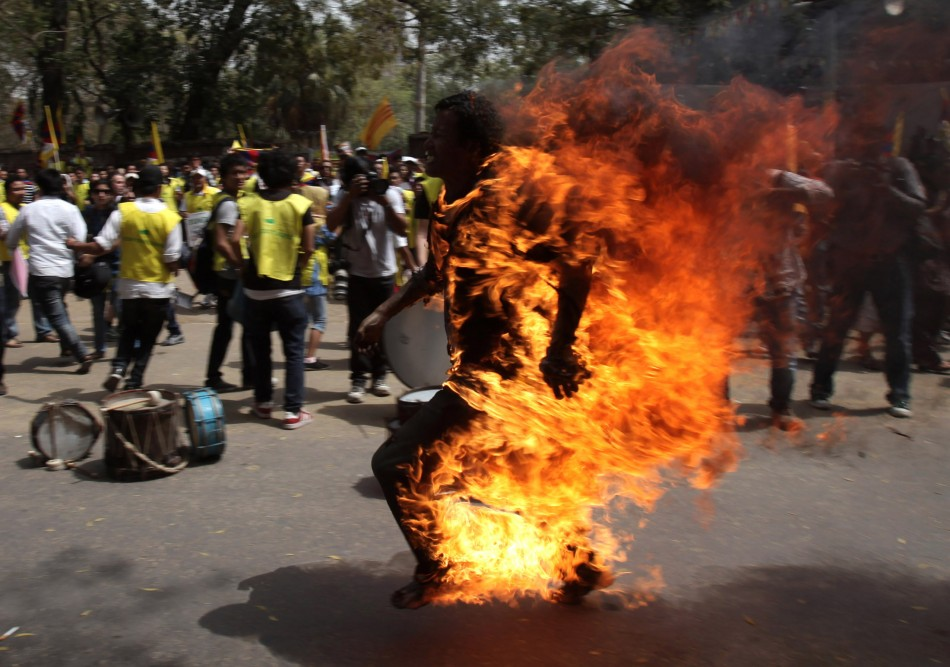Jampa Yeshi, 27, set himself alight near a group of protesters in the central district of Connaught Place in the capital.