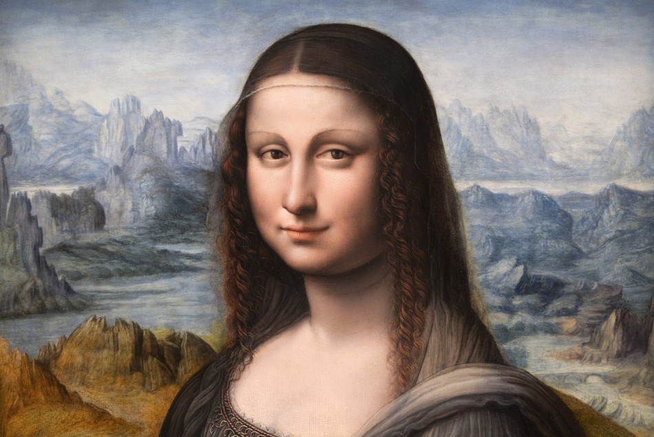 """A copy of Leonardo Da Vinci's famous """"Mona Lisa"""" painting from Madrid's El Prado Museum is displayed during a press presentation at the Louvre museum in Paris"""