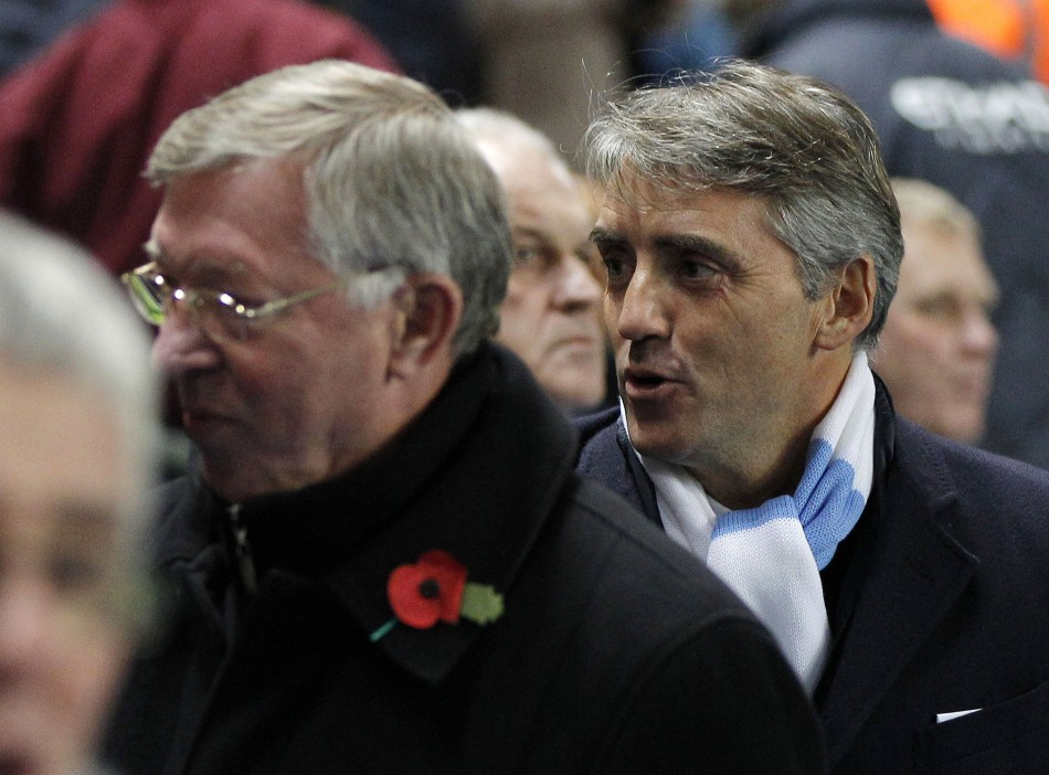 Manchester City's manager Roberto Mancini and  Manchester United manager Sir Alex Ferguson