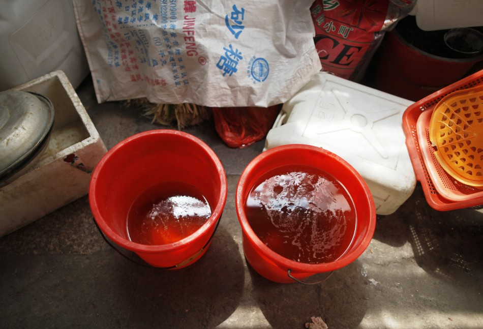 Urine collected from a primary school rest inside a stall selling hard-boiled eggs cooked in boys' urine in Dongyang