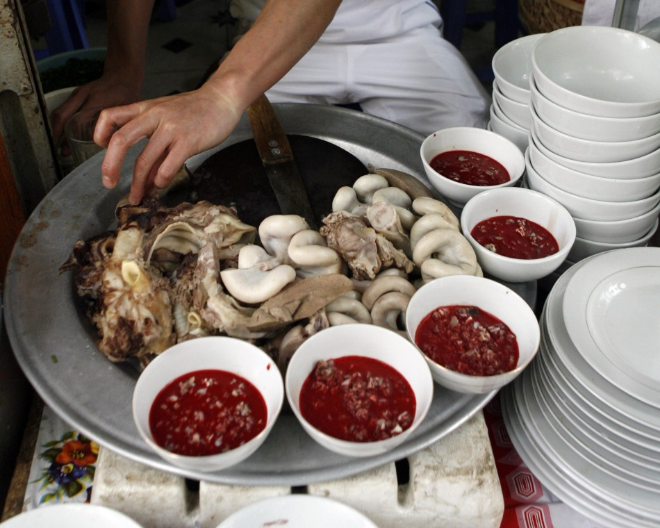Raw blood dish is displayed with cooked entrails at a restaurant in Hanoi