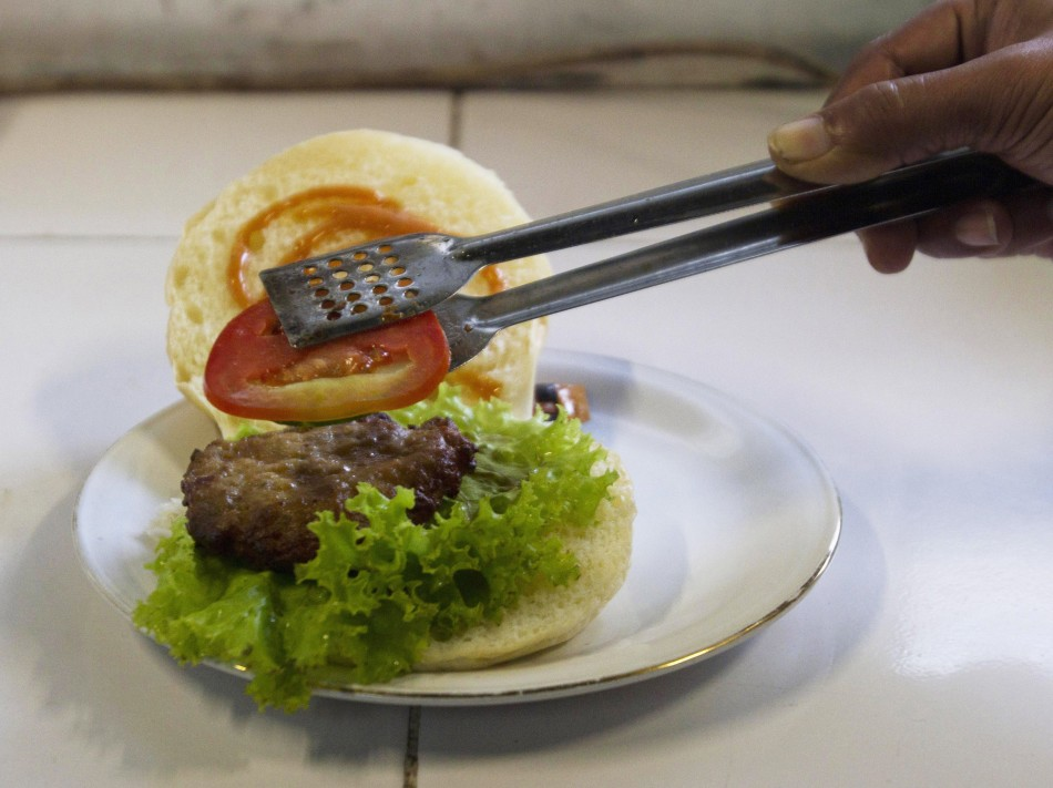 A chef prepares a cobra meat burger at a Chinese restaurant in the ancient city of Yogyakarta