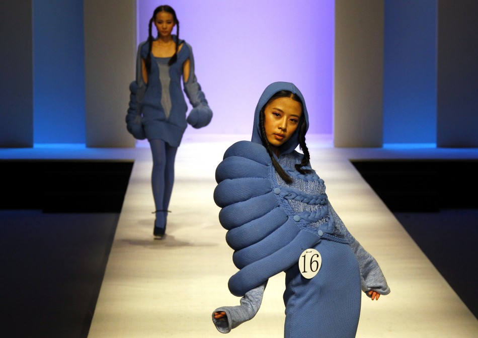 Models present creations at the 2012 China Knitwear Fashion design contest show during China Fashion Week in Beijing