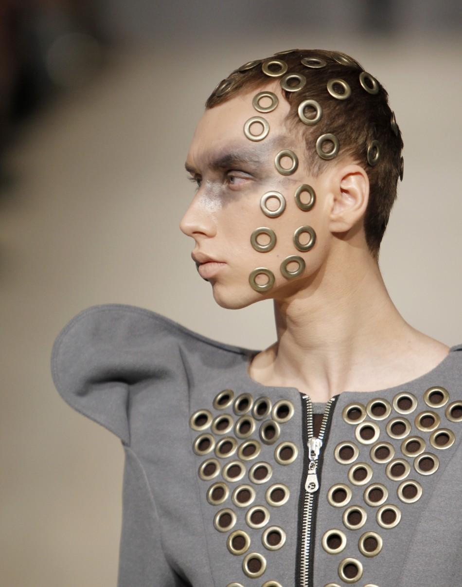 A model presents a creation by Ukrainian designer Komardina during Ukrainian Fashion Week in Kiev