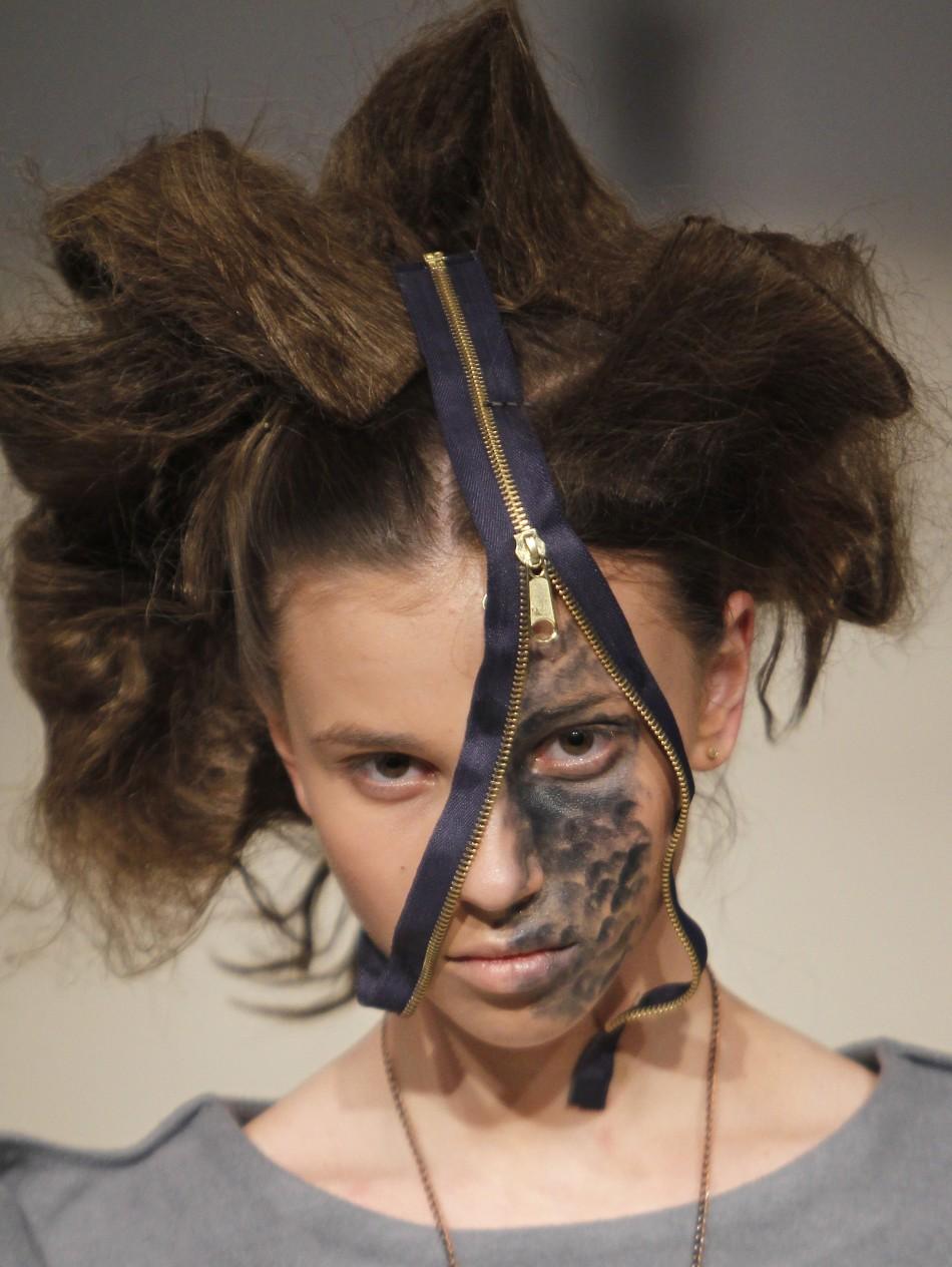 A model presents a creation by Ukrainian designer Liudmyla Komardina during Ukrainian Fashion Week in Kiev