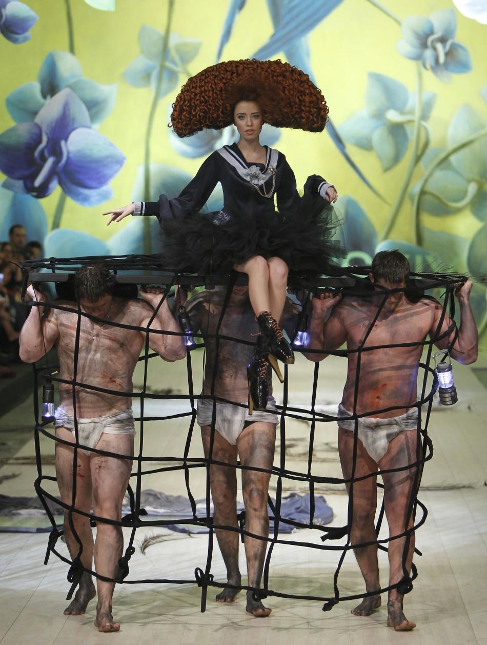 A model presents a creation by Ukrainian designer Oleksiy Zalevskiy during Ukrainian Fashion Week in Kiev