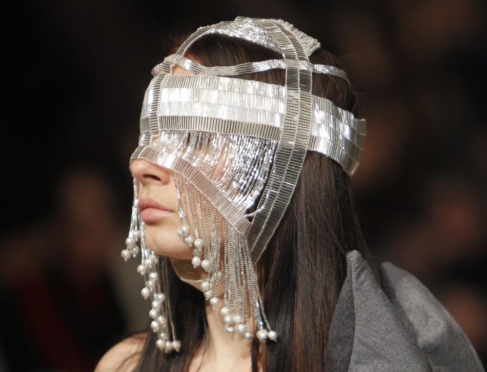 A model presents a creation by Ukrainian designer Gritsfeldt during Ukrainian Fashion Week in Kiev