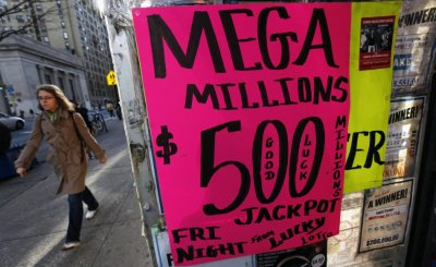 A sign advertises Mega Millions lottery tickets at a shop on New York Citys Upper West Side of Manhattan