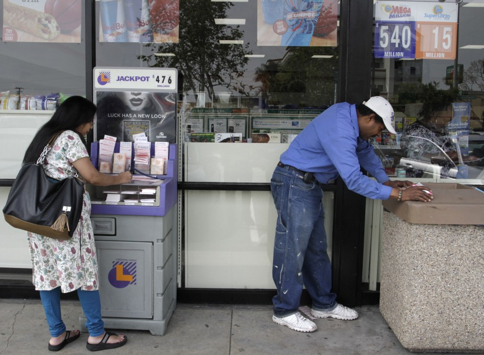 Thompson and Delgado fill out Mega Millions lottery slips for Friday's drawing that has surpassed a jackpot of over $540 million, in Lawndale, California