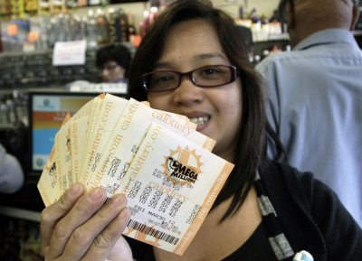 Veronica Balbas holds her Mega Millions lottery tickets for Fridays draw in Lawndale