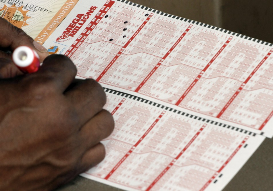 Francisco Delgado fills out a Mega Millions lottery slip for Friday's drawing that has surpassed a jackpot of over $540 million, in Lawndale, California