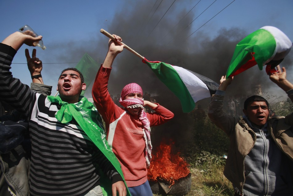 Palestinian protesters during a protest marking Land Day, near the border between Israel and the northern Gaza Strip
