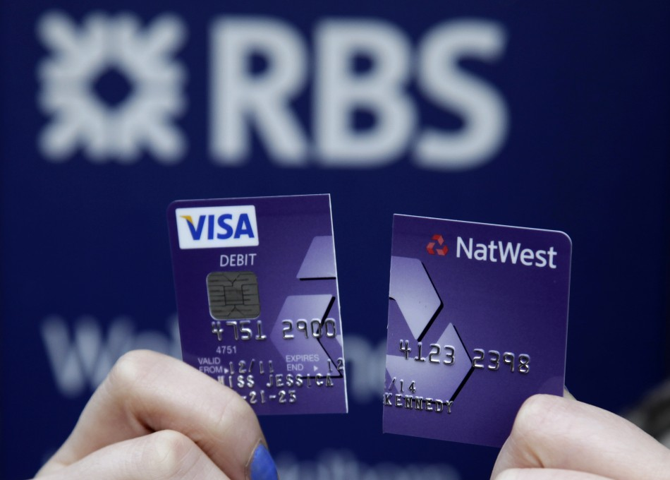 RBS-NatWest customer holds up debit card cut in half to demonstrate dissatisfaction with service following computer glitch