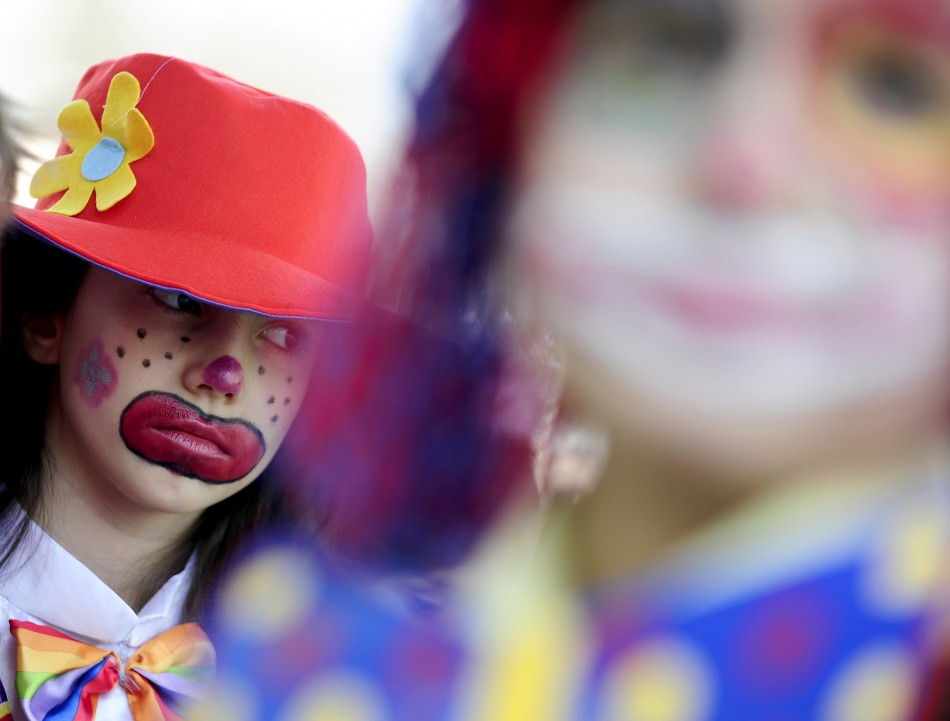 A child in a costume reacts during a traditional April Fool's Day celebration in Skopje