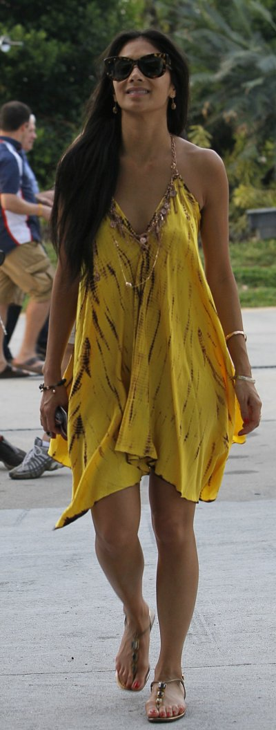 Nicole Scherzinger, girlfriend of McLarens driver Hamilton, walks in the paddock after the qualifying session of the Malaysian F1 Grand Prix at Sepang International Circuit