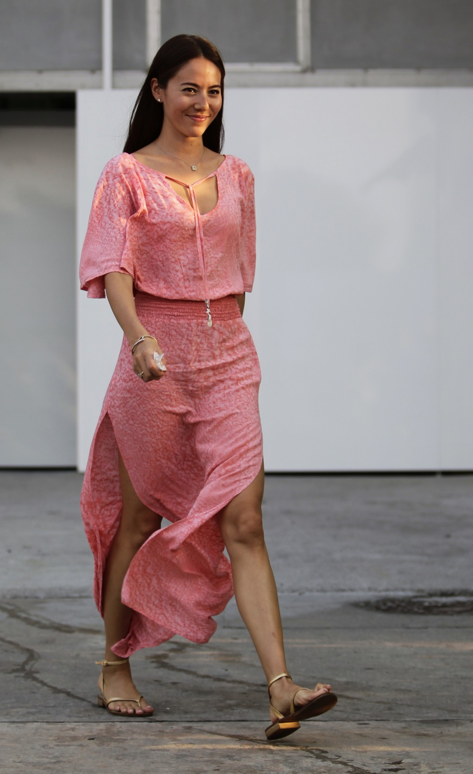 Jessica Michibata, girlfriend of Button, walks in the paddock area after the qualifying session of the Malaysian F1 Grand Prix at Sepang International Circuit outside Kuala Lumpur