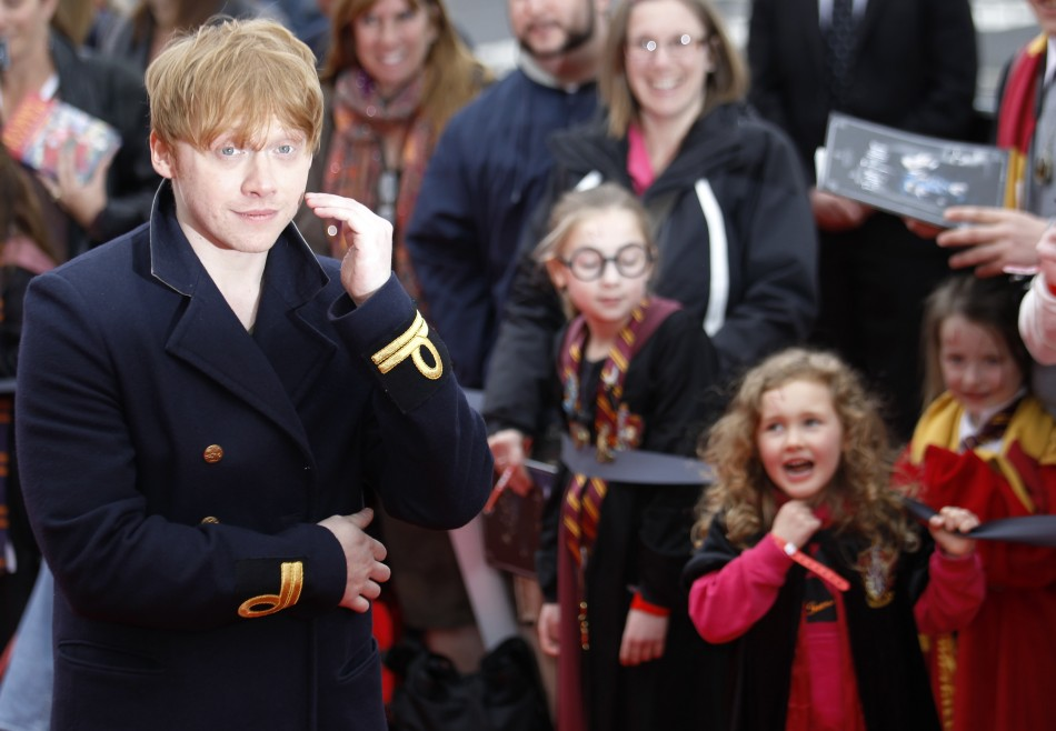 Actor Rupert Grint is cheered by young fans as he arrives at the opening of the Warner Brothers Studio Tour- The Making of Harry Potter north London