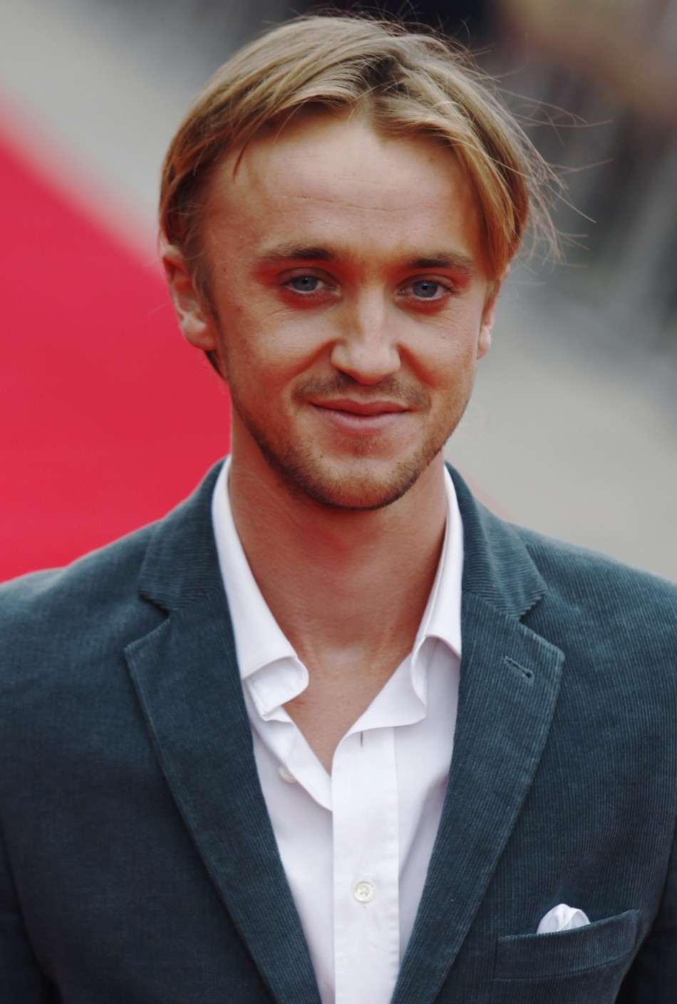 Actor Tom Felton poses at the opening of the Warner Brothers Studio Tour- The Making of Harry Potter near Watford north London