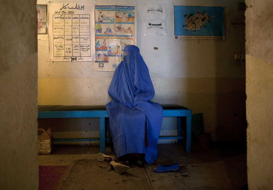 A drug addict waits for her turn to see doctors at the Nejat drug rehabilitation centre, an organisation funded by the United Nations providing harm reduction and HIV/AIDS awareness, in Kabul