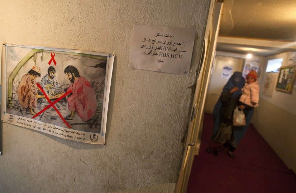 A drug addict holds her child as she visits the Nejat drug rehabilitation centre, an organisation funded by the United Nations providing harm reduction and HIV/AIDS awareness, in Kabul