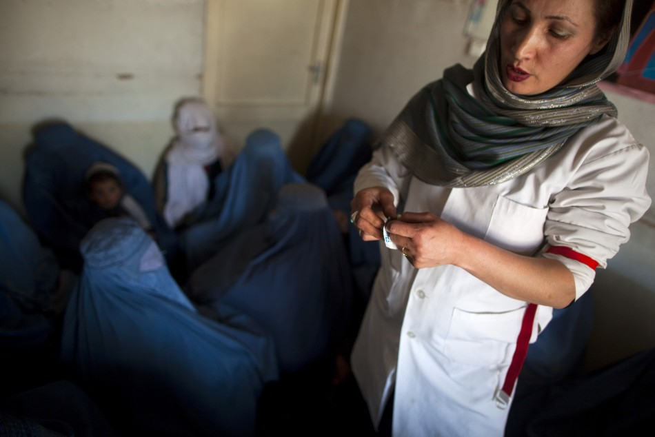 An Afghan doctor explains the use of condoms to a group of women addicts at a counseling session at the Nejat drug rehabilitation centre, an organisation funded by the United Nations providing harm reduction and HIV/AIDS awareness, in Kabul