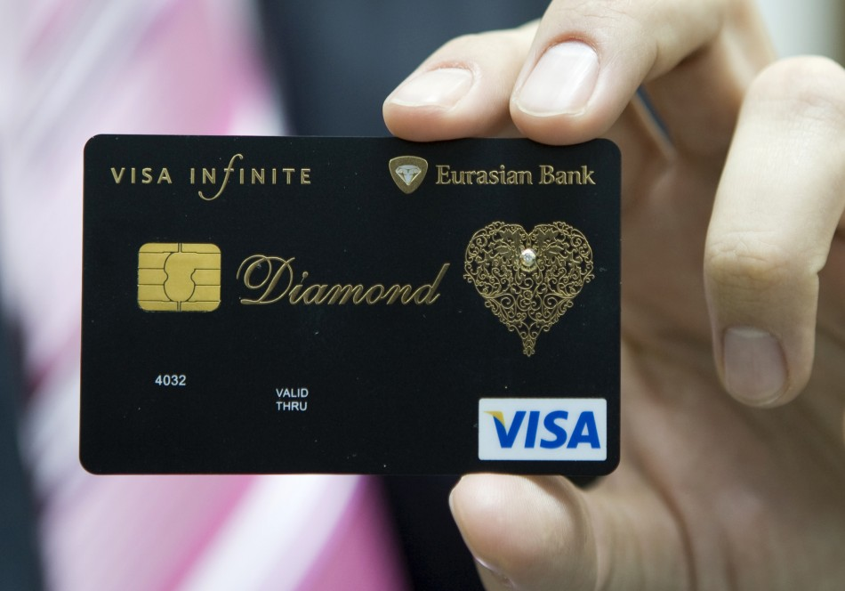 Dmitry Nikolin, the Executive Director of Eurasian Bank, shows a new VISA card encrusted with a 0.02 carat diamond and laced with an elaborate gold pattern in Almaty December 23, 2008.