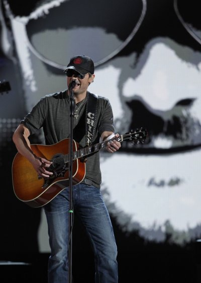 Singer Eric Church smiles performs quotSpringsteenquot at the 47th annual Academy of Country Music Awards in Las Vegas
