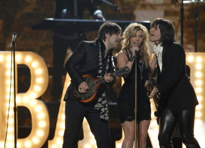 Kimberly Perry and The Band Perry perform quotPostcard From Parisquot at the 47th annual Academy of Country Music Awards in Las Vegas