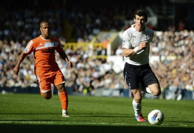 Tottenham Hotspur039s Gareth Bale runs away from Swansea City039s Scott Sinclair during their English Premier League soccer match in London