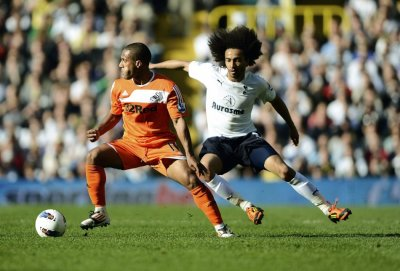 Tottenham Hotspur039s Benoit Assou-Ekotto challenges Swansea City039s Scott Sinclair during their English Premier League soccer match in London