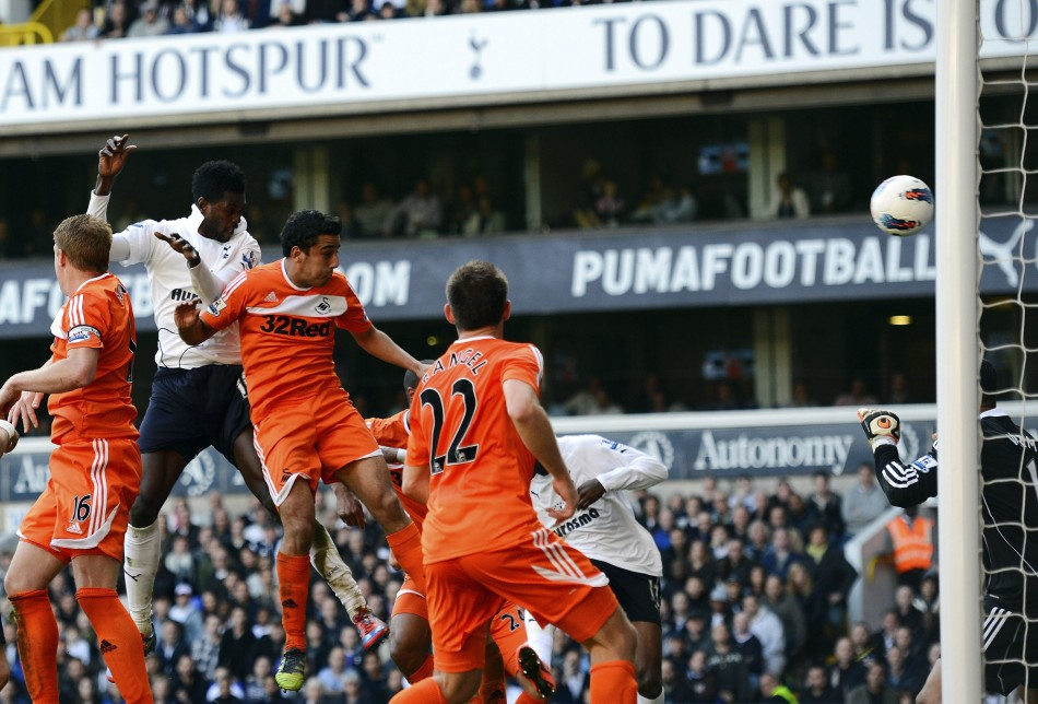 Tottenham Hotspur039s Emmanuel Adebayor rises above the Swansea City defence to score a header during ttheir English Premier League soccer match in London