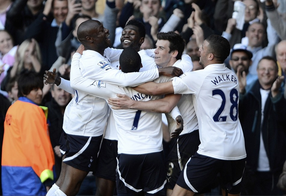 Tottenham Hotspur039s Emmanuel Adebayor is mobbed by team mates as he celebrates his second goal against Swansea