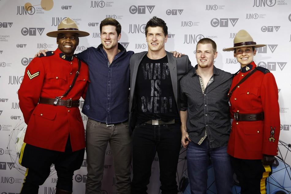 Members of the band High Valley pose with Royal Canadian Mounted Police officers during the 41st Juno Awards in Ottawa