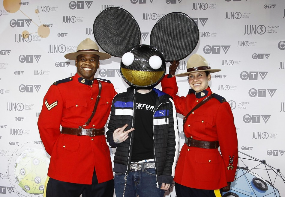 Recording artist 'deadmau5' poses with Royal Canadian Mounted Police officers during the 41st Juno Awards in Ottawa
