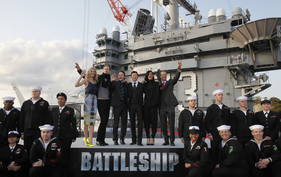 "Cast members of the film ""Battleship"" pose during a news conference atop a flight deck of aircraft carrier USS George Washington at Yokosuka port, south of Tokyo"