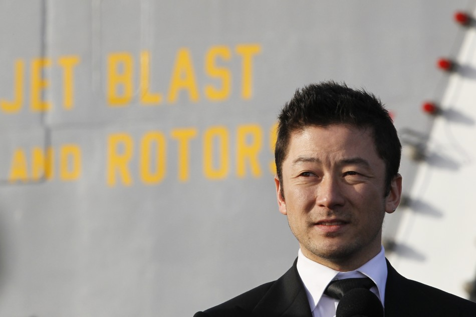 "Japanese actor Asada attends news conference to promote ""Battleship"" at Yokosuka port, south of Tokyo"