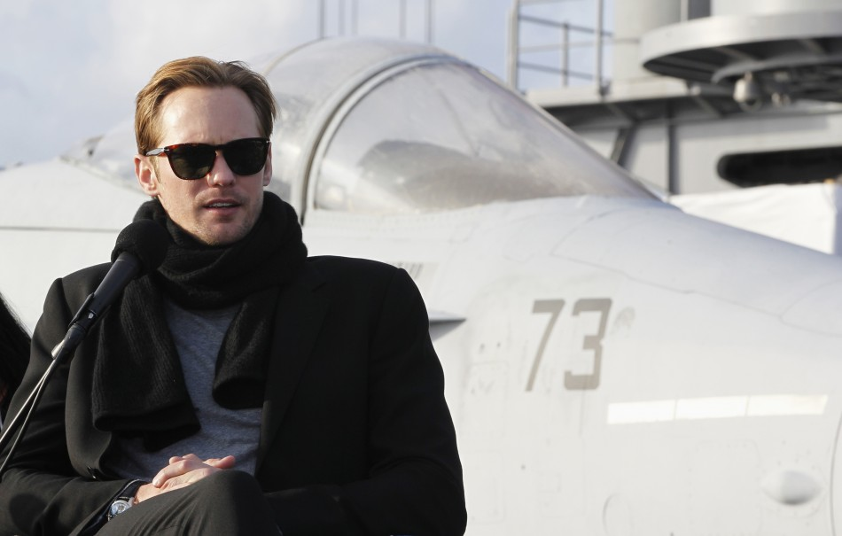 "Actor Skarsgard speaks in front of a U.S. Navy F/A-18 Hornet during a news conference to promote ""Battleship"" at Yokosuka port, south of Tokyo"