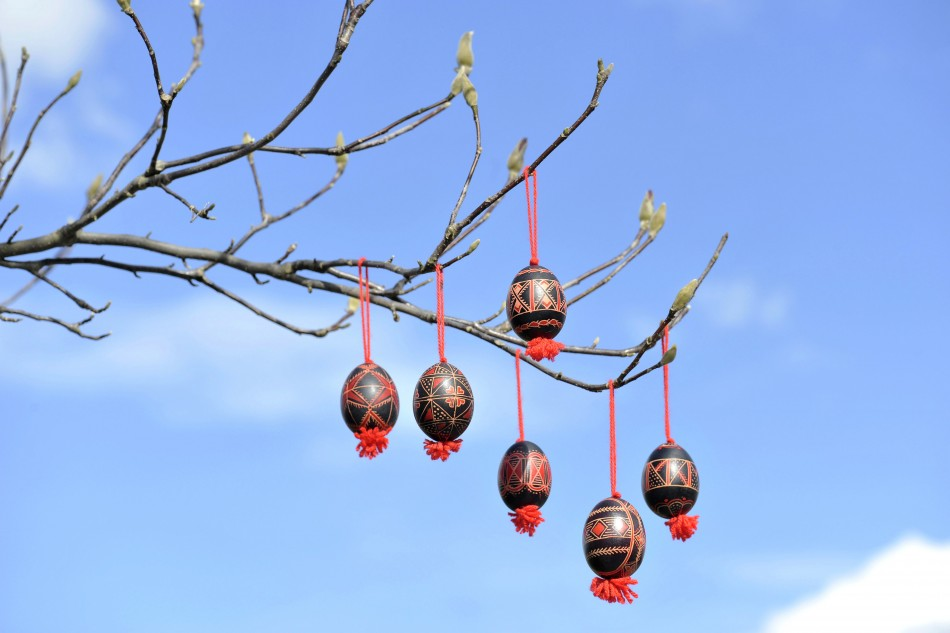 Decorated Easter eggs are seen hanging from a tree in Adlesici