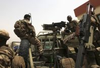 Malian soldiers stand guard at international airport in Bamako